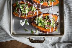 Loaded Baked Sweet Potato with Bacon Guac and Lime-Coconut Cream