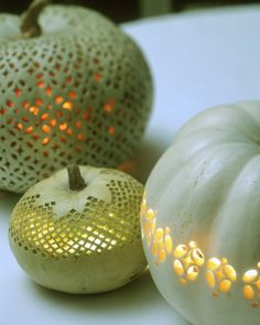 The designs used on these pumpkins, which were carved freehand, mimic the lacelike openwork of 18th-century pierced creamware dishes and turn any pumpkin (especially a pale Lumina) into an intricately patterned lamp.