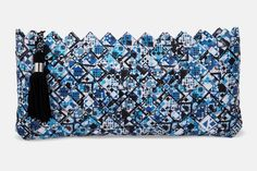 Geometric Blue.  Handmade clutch bag based on geometric pattern with a black zipper and a black handmade tassel of silk thread for pendant.  The pattern is digitally printed and enriched with a professional photographic plastic; providing UV protection in order to maintain and protect the colors adding 100% waterproofness.
