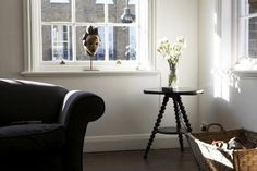 Mat Collishaw, Living Room, wood table with flowers in corner, Camberwell, London | Remodelista