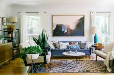L.A. based interior designer, Kaitlin McHugh is inviting us over topeek  inside her beautiful Silver Lake home today. She's definitely got a touch  of earthy, modern boho vibe. Am I right?Her home is just around the corner  fromsome of the finest oysters (L&E) and shops (OK) in town. Totally  jealous. What makes her even more awesome is that she majored in  Printmaking, so we got to talk about our love for intaglio.Kaitlin lives  with her boyfriend,Brendan Hines, who's a musician,and…