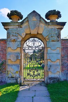 Stone garden arch with an iron gate at Castle Howard