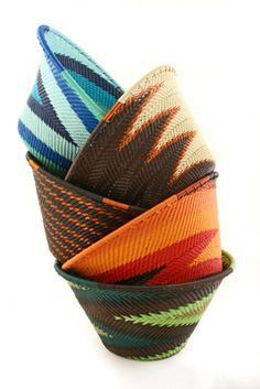 Swahili Telephone Wire Baskets Senzokuhle weavers craft each beautiful basket from purchased telephone wire.