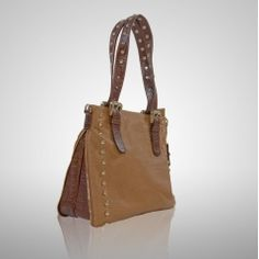 Great all-purpose tote with zippered perimeter to expand the entire body. Two adjustable-length handles, golden studded hardware on straps and bag, detachable shoulder strap, and available in two-tone or tone-on-tone. Practical and hip in one yummy bag. $330
