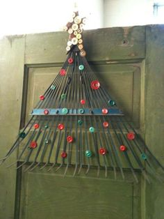 #Upcycle an old rake into a #Christmas tree hanging decoration.  Good for an outdoor decoration too!