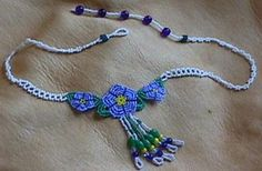 These Bead Embroidered Forget-Me-Not flowers submitted by Glenda Stubblefield simply glow