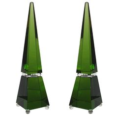 Large emerald green cut glass obelisks by murano master Romano Dona. Each one signed on the base Romano Dona, Murano. Featuring clear glass spheres fused to the cut and polished green glass sections.