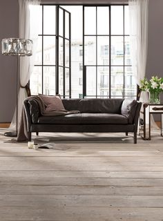 A stunning leather sofa, ideal for adding a little character to hallways, landings and making the most of smaller spaces. This refined piece is covered with beautiful Old Saddle leather, from each plump arm and back cushion all the way down to the leather-clad legs.
