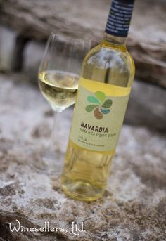 Navardia Blanco Organic Rioja    This wine shows a fresh citrus and mineral flavor. Although it can be aged for a decade or more, it is most appealing in its youth. This wine has intense and attractive aromas and flavors of tropical fruits and citrus, with a fresh and elegant finish.  http://www.winesellersltd.com/wine/DOC%20Rioja/Navardia/Navardia%20Blanco%20Organic%20Rioja/2014.html