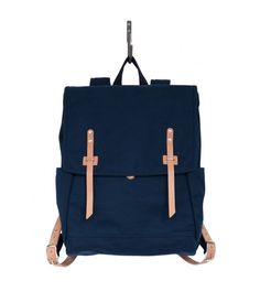 Farm Rucksack - Navy. The Farm Rucksack is a simple piece made from 100% heavy cotton duck, along with undyed Horween distressed leather detailing. Heavy cotton webbing make this backpack extremely durable. Padded shoulder straps, unique exterior closures, a snap pocket at the front, two side pockets and one generous main compartment make this the perfect travel companion.