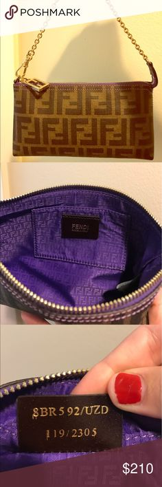 Fendi Spalmati Zucca Pochette New without tags, comes in original Fendi box. This stylish pochette is crafted of spalmati coated canvas with signature FF zucca print. The stitching and zipper panel are luscious purple and the pochette features a gold chain wrist strap. The polished gold zipper pull opens to a luscious purple Fendi fabric interior with a patch pocket. Fendi Bags Clutches & Wristlets