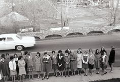 28 unidentified young women at the edge of the LXA frat house lawn (1967)