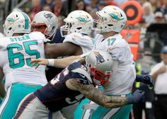 New England Patriots defensive end Chris Long (95) hits Miami Dolphins quarterback Ryan Tannehill (17) after he threw a pass during the first half of an NFL football game Sunday, Sept. 18, 2016, in Foxborough, Mass.