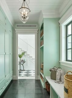 Welcoming mint green mudroom features a glass bell jar lantern hung from a white shiplap ceiling in front of mint green closed lockers located above drawers accented with polished nickel pulls. Mint Green Rooms, Mint Green Paints, Mint Green Decor, Mint Rooms, Green Decoration, Mint Green Aesthetic, Mint Green Walls, Green Painted Walls, Flur Design