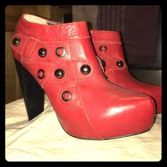 Red/black all leather ankle booties. Size 8.5 Very fun red leather ankle booties! Never worn! Grey City Shoes Ankle Boots & Booties