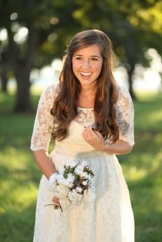 Adorable bride in a sweet lace 3/4 sleeve wedding dress