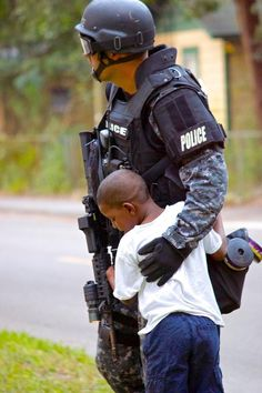 During a training exercise, this little guy just wanted to hug a real life hero, and he didn't want to let go...