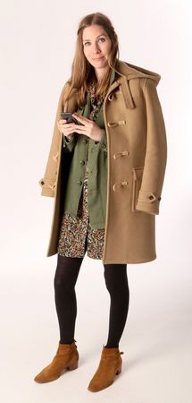 This men's Saint Laurent Duffle Coat is a favorite of Mary's. It's a beautiful camel wool and it retails for $2,690. She's layering it with a vintage floral dress ($3) and a vintage Army shirt from an LA vintage shop ($50). She has several for sale in the shop. They're a good layering piece. Her Saint Laurent Signature Jodhpur 40 Boots in Suede are another favorite. They retail for $995. (Allison Carey/The Plain Dealer).