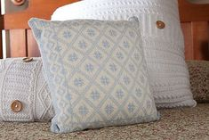 The ULLARED CUSHION draws on traditional Swedish colorwork patterns to make an attractive pillow cover.