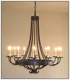 wrought iron chandelier + custom shades and different candle covers