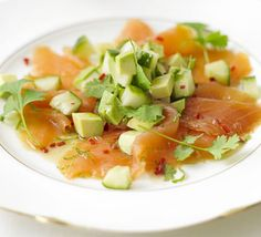 Smoked salmon with Asian dressing - A mix of chilli, lime, sesame and soy plus avocado turns a traditional smoked salmon starter into a new taste sensation Smoked Salmon Starter, Smoked Salmon Salad, Salmon Avocado, Avocado Salad, Cucumber, Bbc Good Food Recipes, Cooking Recipes, Asian Dressing, Salads