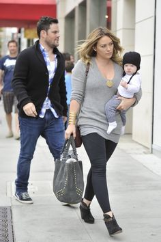 Hilary Duff takes her baby Luca shopping on Rodeo Drive with her husband. The group headed to Tom Ford for a bit of shopping before heading to Il Pastaio for lunch.