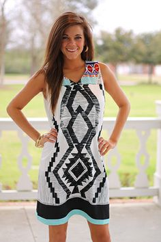 """AZTEC ALERT!! This one features an abstract Aztec design that is super cool, and the color combo is not too shabby either. Just add a funky pair of wedges and out the door you go!! Fits true to size. Miranda is wearing the small. From the shoulder to the hem: S-35"""" M-35.5"""" L-36"""""""