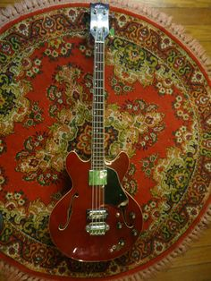 Vintage 1977 Aria Hollow Body Bass Model 3520 Clean EB2 Matsumoku   Awesome shortscale bass. If I had money I'd throw it at this thing because they play well and sound amazing.