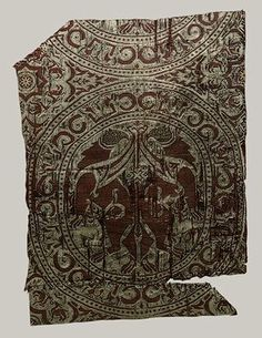 Textile fragment, first half of 12th century  Spain  Silk and gold-wrapped silk; a compound weave  17 x 12 in. (43.2 x 30.5 cm)