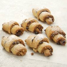 Rugelach - Satiny soft dough made with butter, cream cheese, and sour cream wraps around a filling of sugar, nuts, and raisins.