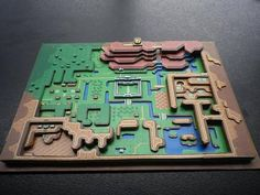 Gain a new perspective on the world of Zelda with this paper diorama of the Legend Of Zelda: A Link to the Past map. Designed by artist Wuppes of Luxemberg, this handmade diorama is a must have collectible for Zelda geeks. The Legend Of Zelda, Zelda Map, Link Zelda, Classic Nes Games, 3d Pokemon, Creation Deco, Video Game Art, Geeks, Game Design
