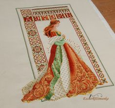 Celtic Autumn cross stitched woman - Done in orange tones