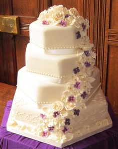 "https://flic.kr/p/anzQXd | blossom wedding cake in ivory | <a href=""http://www.thesweetestthing.co.uk"" rel=""nofollow"">www.thesweetestthing.co.uk</a>    another version of my blossom wedding cake in ivory & purple, I really loved the way this one looked, the colours were lovely."