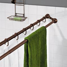 Shower curtain rod with attached towel rod