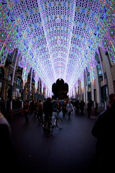 Luminarie De Cagna, an Italian company specializing in illuminated installations, converted a street into a monumental facade and hall lit by 55,000 LEDs for the 2012 Light Festival Ghent in Belgium. The light installation is visible in the beginning of this light festival video by Lieven Vanoverbeke