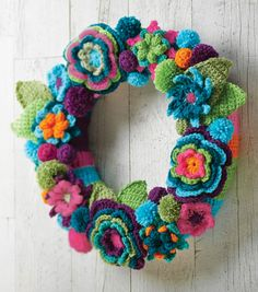 Crochet Flower Wreath Free Crochet Pattern. SUPPLIES & TOOLS: 14″ straw wreath Crochet hooks: Size US F/5, Size US H/8, Size I/9 Size J – 10mm Yarn needle Scissors Red Heart® yarn, assorted colors Note: Colors are not assigned in the directions so you can determine what colors are best for your wreath. Free Pattern More Patterns Like This!
