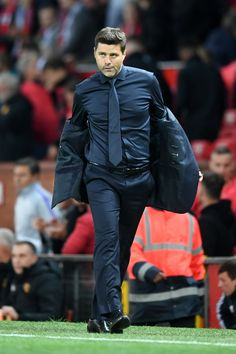Mauricio Pochettino, Manager of Tottenham Hotspur walks off the pitch for half time during the Premier League match between Manchester United and Tottenham Hotspur at Old Trafford on August Get premium, high resolution news photos at Getty Images Tottenham Hotspur Football, Mauricio Pochettino, Premier League Matches, Lakme Fashion Week, Old Trafford, North London, Gentleman Style, Man Crush, Pitch