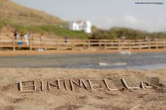 Binimel.la  Beach  in Menorca - Balearic Island   Letters made with small wood on the beach sand    Karlos Hurtado Photographer 2012  all rights reserved