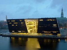 Black Diamond Building waterfront extension of The Royal Library, The National Library of Denmark and Copenhagen University Library, 1999, designed by schmidt hammer lassen, black marble plates and dark glass exteriors, includes a concert hall, exhibition galleries, and a cafe