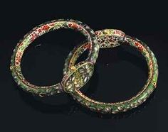 A pair of enamelled and gem-inset gold anklets | North India, late 19th century