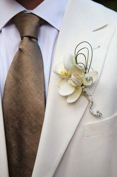 White Orchids Boutonniere | Vanilla and Champagne Inspiration | Colin Cowie Weddings