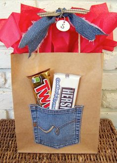 cool wrapping paper ideas... kraft paper bag, red tissue paper, ribbon, and denim pocket patch - too cute! ...think i finally got you on that one...