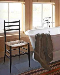 A simple cast-iron tub -- complete with views of the property -- takes center stage in this master bathroom.
