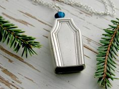 Coffin necklace - hollow knife bell - knife stem - recycled flatware - halloween jewelry - silver - vintage silverware metallic blue crystal