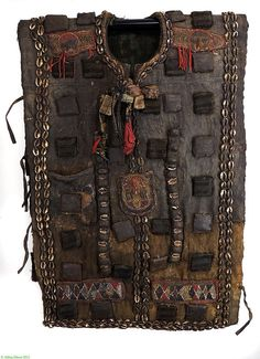 27 jun 13 [Africa | Hunters Tunic from the Yoruba people from the Ekiti region | Cotton, beads, cowrie shells, leather and amulets | ca. 1st half of the 20th century]