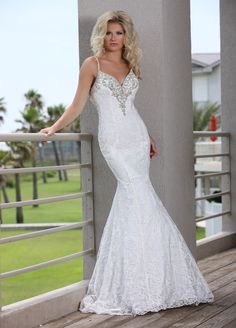 Show off your stunning curves in the slim and sophisticated lace mermaid wedding dress that is Style 50254. Beautiful, floral lace covers this gown and ends in a pretty, scalloped trim at the hem of the skirt and chapel-length train. Delicate, beaded spaghetti straps plunge into a bedazzled, deep V neckline in the front and a deep scoop back accented with even more intricated beading and a line of buttons. This lovely gown would be a perfect beach wedding dress.