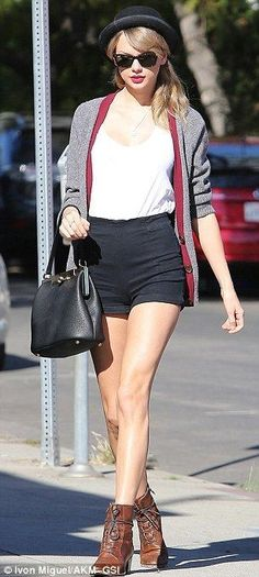 Taylor Swift shows off her long legs in a tiny black mini skirt - Celebrity Street Style