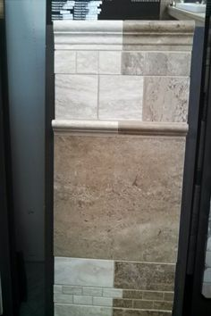 Large brown travertine tile for kitchen floor other trim behind stove