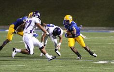 Marcus Wiltz gets as many yards as he can on the run.