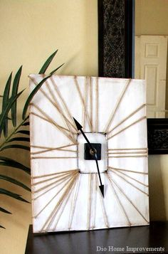 diy wall clock with yarn and a picture frame